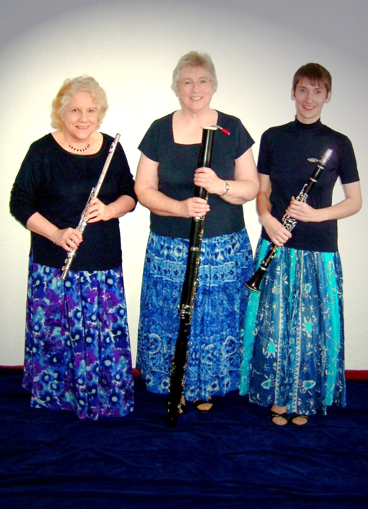 Trio in long blue skirts
